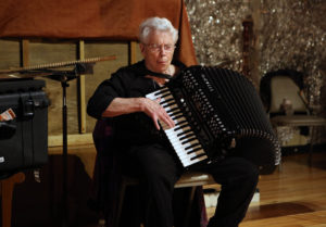 photo of Pauline Oliveros playing accordian